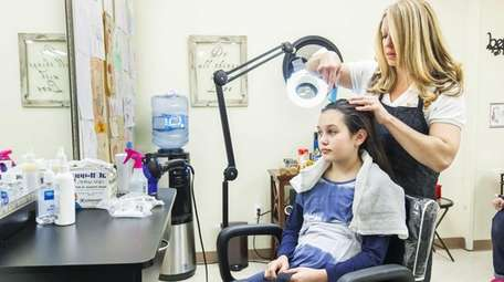 Melissa Levin of Dix Hills, owner of Lice