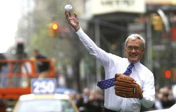 David Letterman throws a pitch to New York