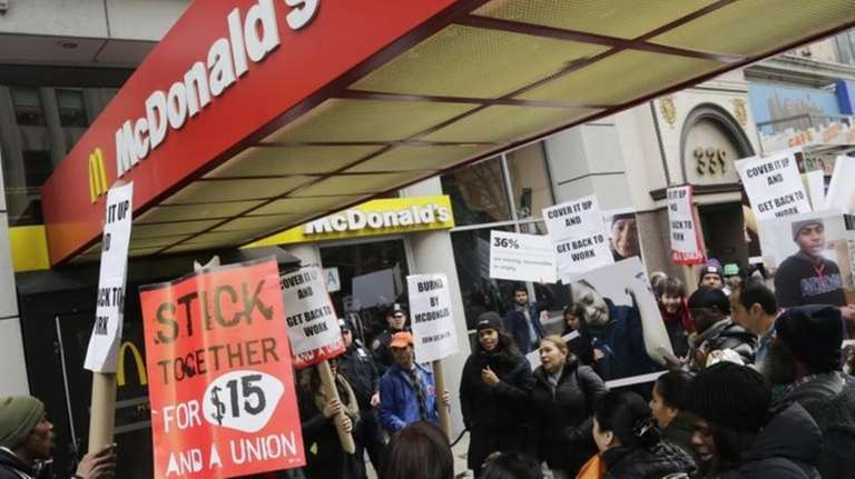 Dozens of fast-food workers and their supporters protest