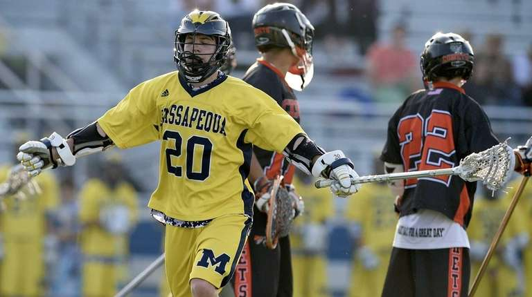 Massapequa attacker Carter Hawthorne (20) celebrates after scoring