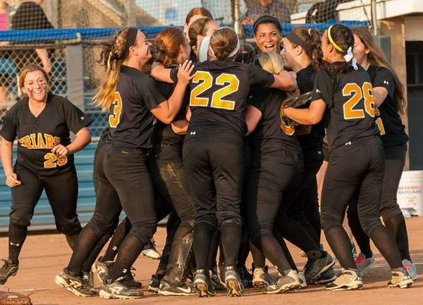 St. Anthony's celebrates at home plate after defeating