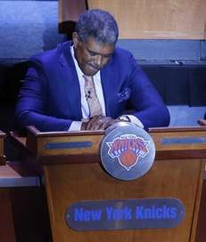 Knicks general manager Steve Mills reacts to getting