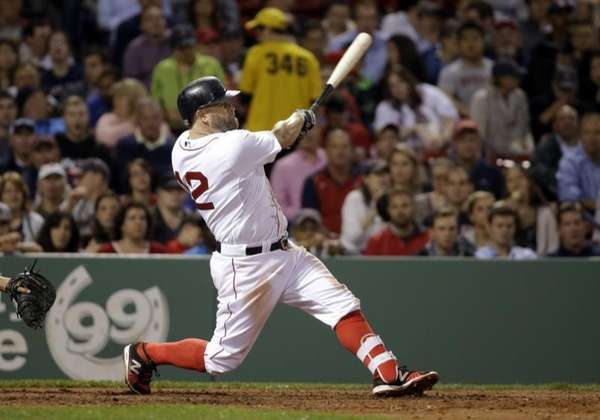 Boston Red Sox's Mike Napoli hits a solo