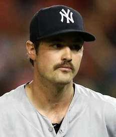 New York Yankees pitcher Andrew Miller looks on