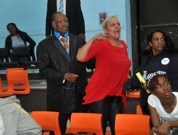 Hempstead resident Gypsy Jefferson, center, grows irate during