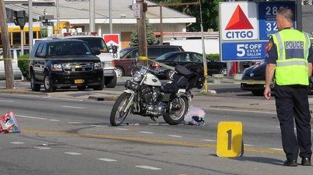 Nassau County police investigate the scene of an