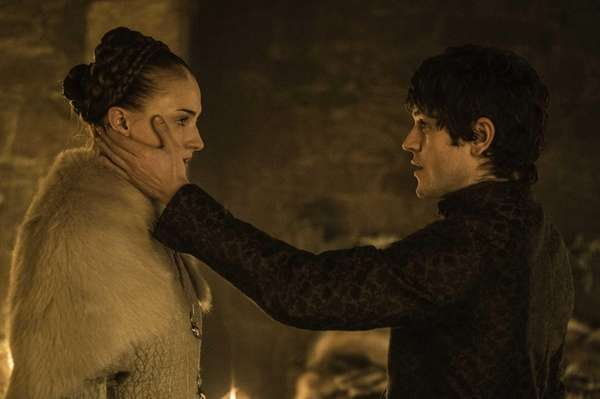 Sophie Turner as Sansa Stark and Iwan Rheon