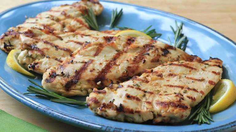 Chicken breasts are pounded and marinated in rosemary,
