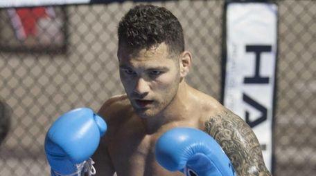 Undefeated UFC Middleweight Champion Chris Weidman, of Baldwin,