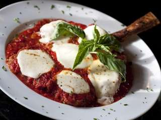 Veal Parmigiana is a house specialty at Pulcinella