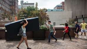 Emma Sulkowicz carries a mattress in protest of