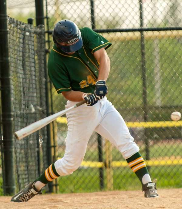 Ward Melville's Joe Flynn takes a swing during