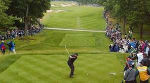 Tiger Woods tees off on the fourth hole