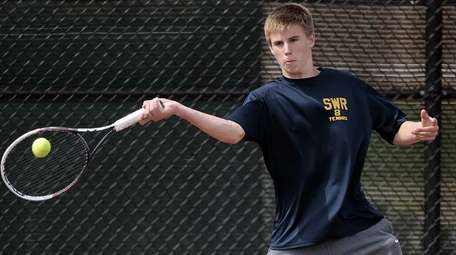 Shoreham-Wading River's Christopher Kuhnle hits a forehand return