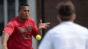 Hills West's Duane Davis aims the backhand volley