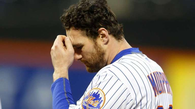 Daniel Murphy of the Mets looks on after