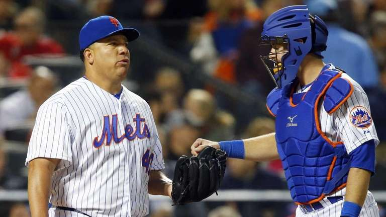 Bartolo Colon #40 and Kevin Plawecki #22 of