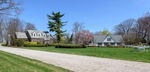 Rolling lawns, a guest cottage and an in-ground