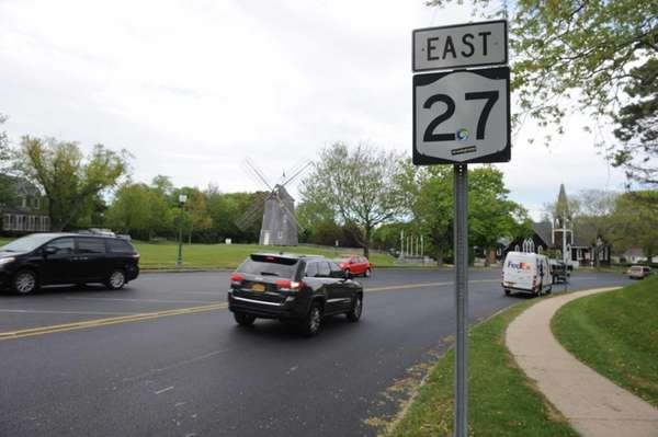 Cars head east on the newly paved Route