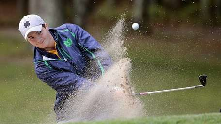 Northport's Sean Healy blasts out of the trap