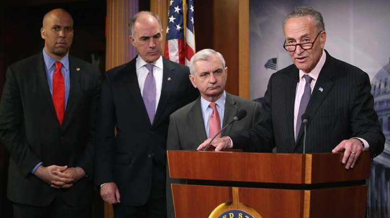 Sen. Charles Schumer (D-N.Y.), right, speaks about Amtrak