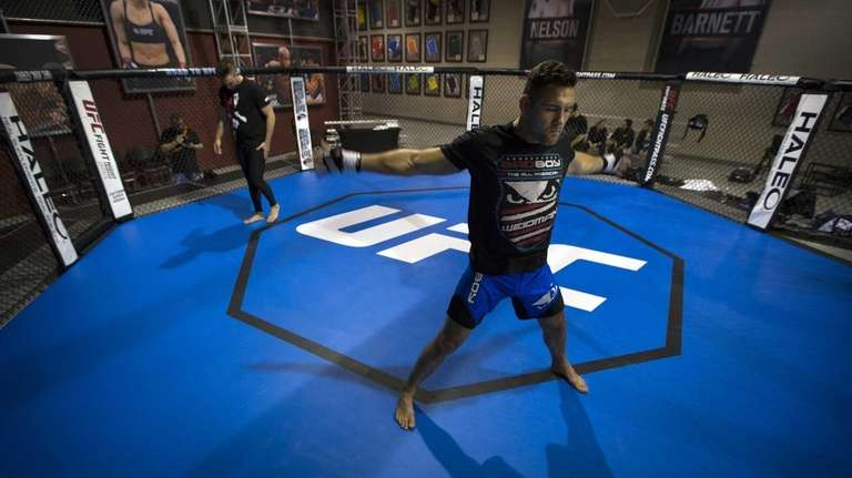UFC middleweight champion Chris Weidman loosens up before