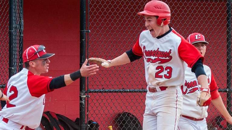 Connetquot players congratulate first baseman Brandon Morse (23,