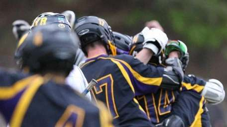 Sayville celebrates after Ashton Bradley scored the game-winning