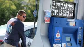 Joe Zito fills up his tank on Wednesday