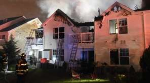 Firefighters battle an early morning fire at the