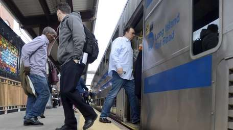 Long Island Rail Road passengers board their train