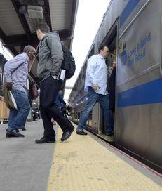Long Island Rail Road passengers board their train