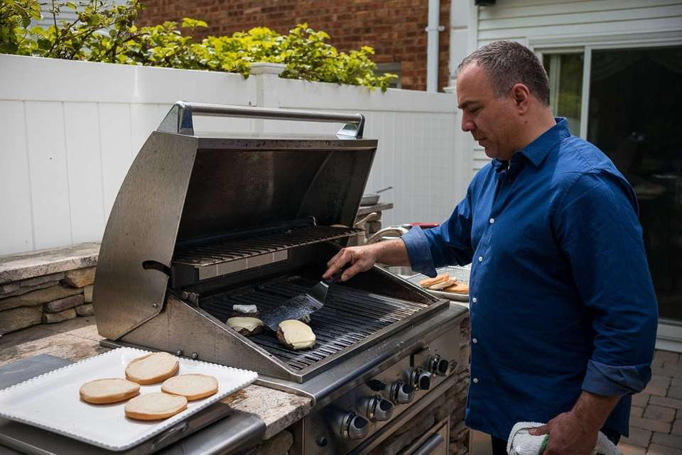 After an initial sear, Russo keeps his burgers