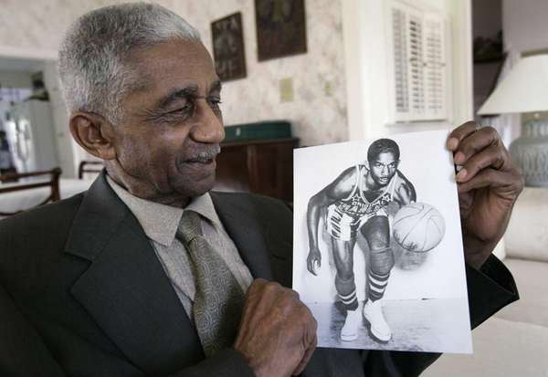 Former Harlem Globetrotters great Marques Haynes holds a