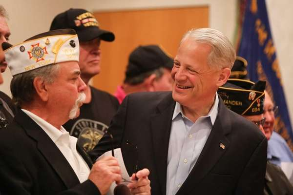 Rep. Steve Israel, right, greets Bill Walden, commander