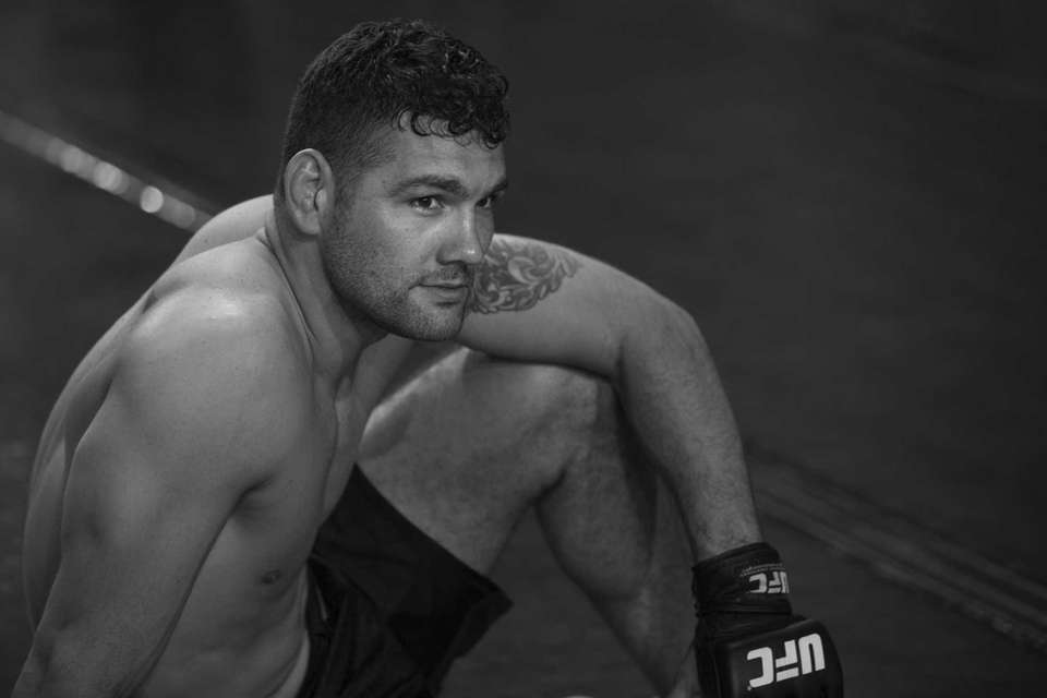 UFC middleweight champion Chris Weidman rests after completing