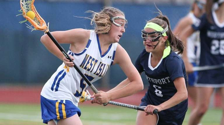 West Islip's Emily Beier (5) tries to get