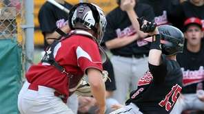 Plainedge's Anthony Misciagna slides home safely during the