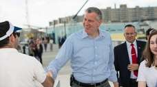 Mayor Bill de Blasio greets folks on Friday,