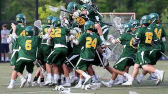 Ward Melville celebrates their 11-10 victory over Northport