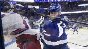 Tampa Bay Lightning center Alex Killorn (17) checks