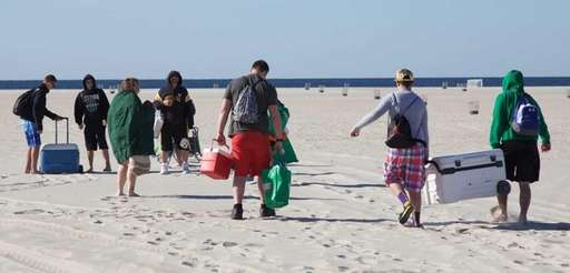 People arrive at the beach before the 12th