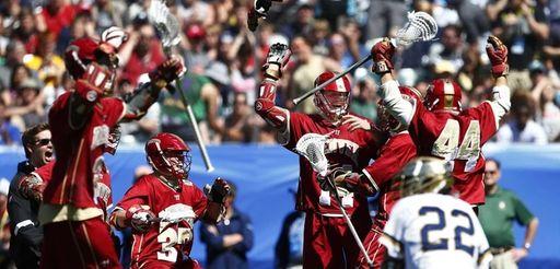 Denver's Wesley Berg (14) raises his arms as