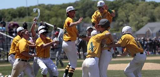 Ward Melville pinch-hitter Nick Rizzi (black helmet) is