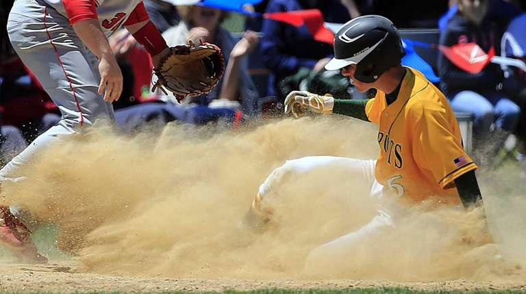 Ward Melville's Brandon Lee reaches third on a