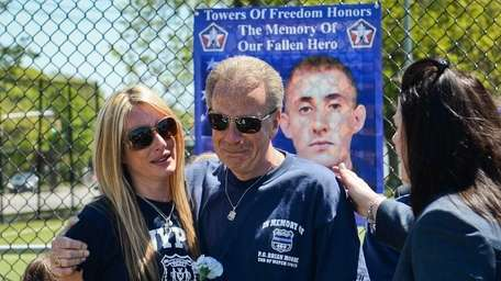 Retired NYPD Sgt. Raymond Moore, father of slain