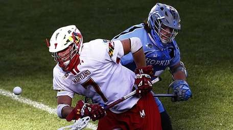 Maryland's Charlie Raffa (7) catches the ball as