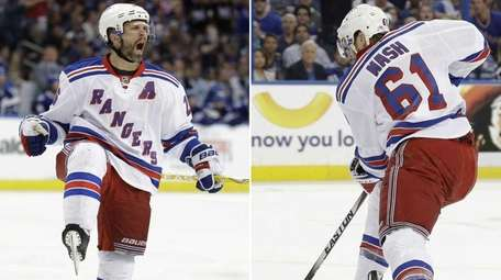 The Rangers' Martin St. Louis, left, and Rick