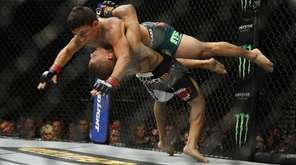 John Moraga, bottom, takes down Joseph Benavidez during