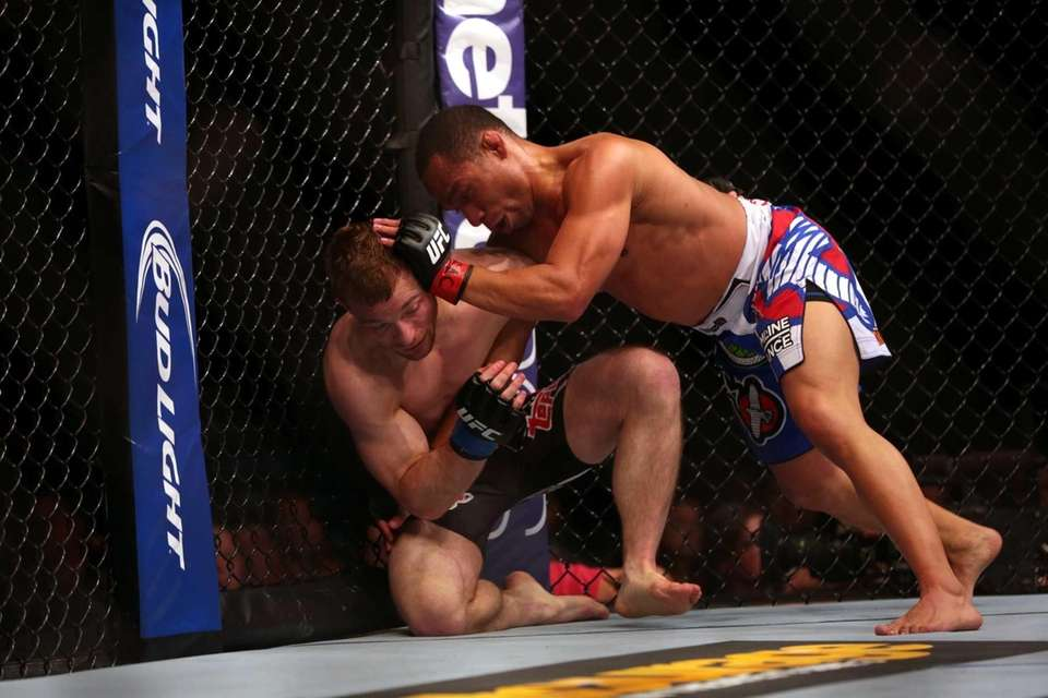 Flyweights John Dodson and Zach Makovsky fight at